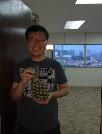 "The chinese traditional of bringing a ""Ong Lai"" (pineapple) to the new office. Pineapple in hokkien means wealth come."